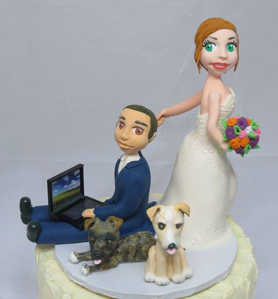 Bride dragging groom gaming cake topper