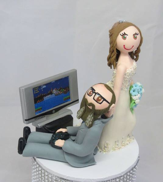 "Bride dragging groom ""Gamer"" theme Cake Topper"