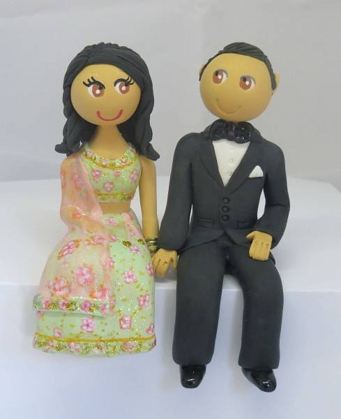 Sitting traditional Indian outfit cake topper