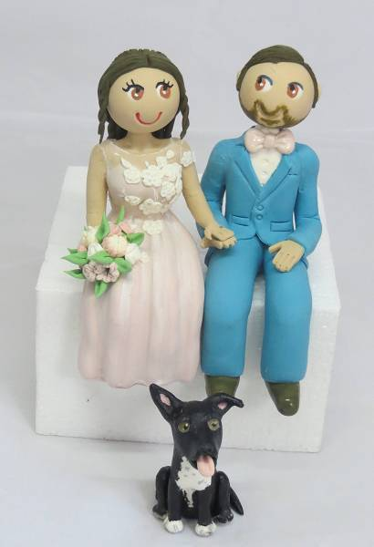 Sitting Bride & Groom with dog